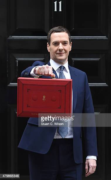 The Chancellor of the Exchequer George Osborne holds his ministerial red box up to the media as he leaves 11 Downing Street on July 8 2015 in London...