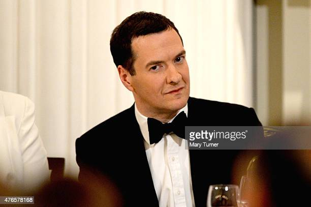 The Chancellor of the Exchequer George Osborne listens to the Governor of the Bank of England Mark Carney as he gives his speech at the annual 'Lord...
