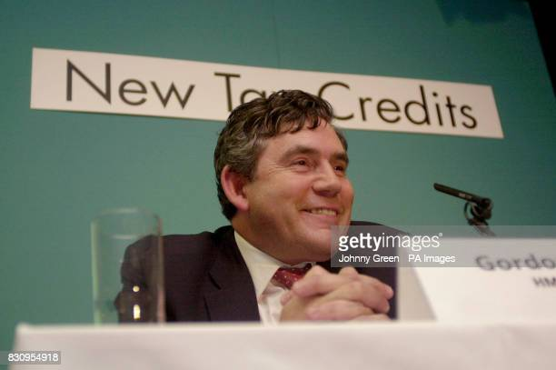 The Chancellor of the Exchequer Gordon Brown grins during a press conference inside the new Treasury buildings in central London after launching a...