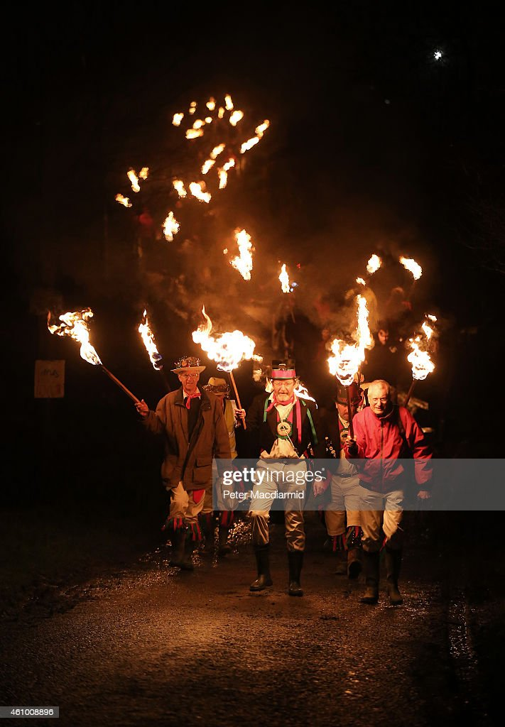 The Chanctonbury Ring Morris Men lead a procession to the orchard during an apple howling ceremony at Old Mill Farm on January 3, 2015 in Bolney, England. In this ancient ritual villagers surround the oldest and largest tree in the orchard, evil spirits are driven out and good spirits are encouraged to produce a bountiful apple crop for the following year's cider drink.