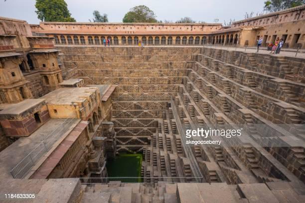 the chand baori is a stepwell built over a thousand years ago in the abhaneri village of rajasthan. - stepwell bildbanksfoton och bilder