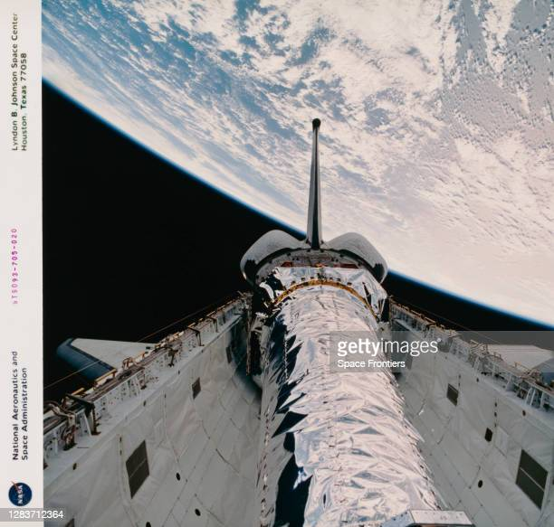 The Chandra X-ray Observatory, against a background of the Earth, ahead of the observatory's release from the payload bay of the Space Shuttle...