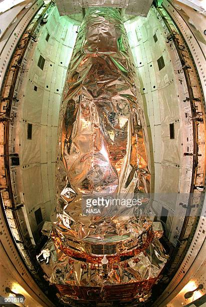 The Chandra X-ray Observatory rests inside the payload bay of the orbiter Columbia at the Kennedy Space Center in florida, June 27, 1999. Chandra is...