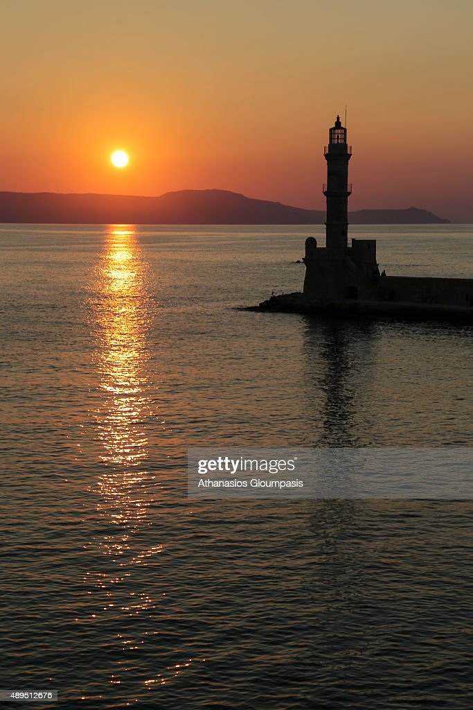 The Chania lighthouse at the sunset at the Venetian old port on July 16, 2015 in Chania, Greece. The lighthouse is a distinctive feature of the harbour. It was built at the harbour entrance by the Venetians and restored in its present form by the Egyptians .The lighthouse is one of the most-photographed monuments in Crete.