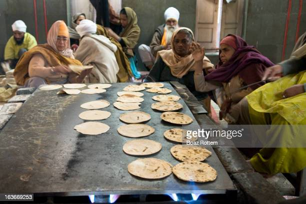 CONTENT] The Chapati bakery at the Golden temple complex in Amritsar India