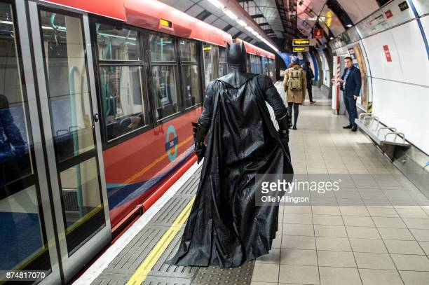 The character Batman from the Justice League film poses in character on the London Underground during a photocall en route to The Leicester Square...