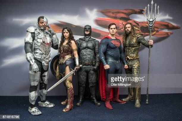 The character Cyborg Wonder Woman Batman Superman and Aquaman from the Justice League film pose in character infront of film based promotional...