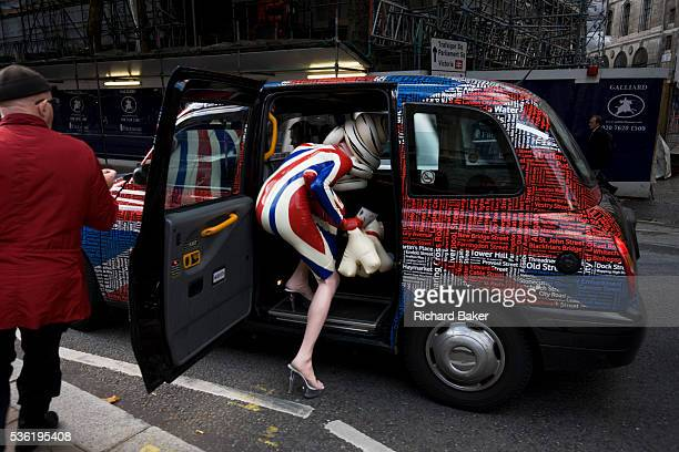 The character known as Pandemonia partparody living sculpture and fine artist leaves a London fashion show in a London taxi cab during Fashion Week...