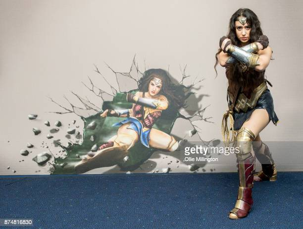 The character Wonder Woman from the Justice League film poses in character infront of film based promotional artwork unveiled for the first time...