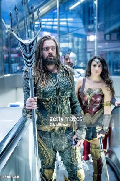 The characters Aquaman and Wonder Woman from the Justice League film pose in character on the London Underground during a photocall en route to The...