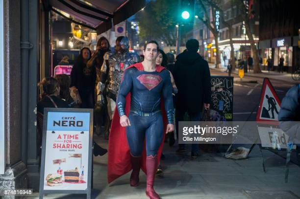The characters Aquaman Cyborg Superman and Wonder Woman from the Justice League film poses in character outisde before the UK premier during a...