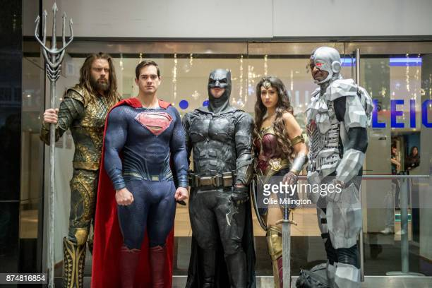 The characters Aquaman, Superman, Batman, Wonder Woman and Cyborg from the Justice League film pose in character outisde the UK premiere during a...