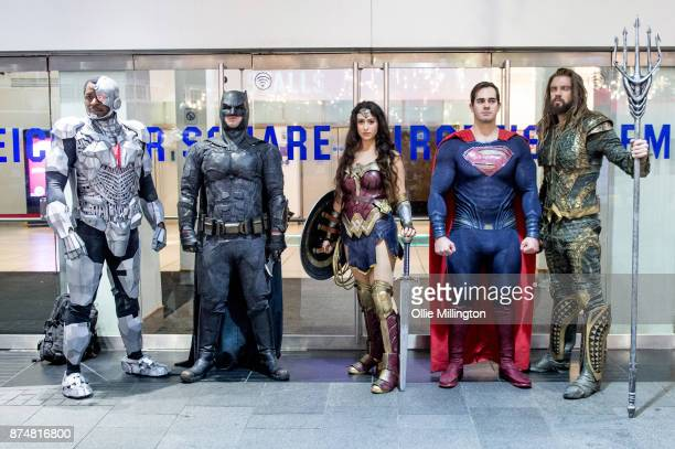 The characters Cyborg Batman Wonder Woman Superman Aquaman and from the Justice League film pose in character outisde the UK premiere during a...
