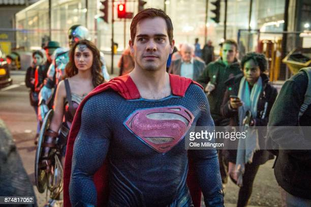 The characters Cyborg Wonder Woman and Superman from the Justice League film poses in character outisde the UK premier during a photocall at The...