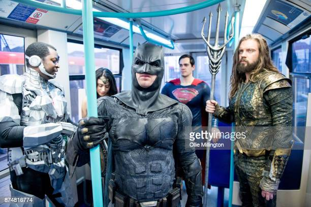 The characters Cyborg Wonder Woman Batman Superman and Aquaman and Wonder Woman from the Justice League film pose in character on the London...