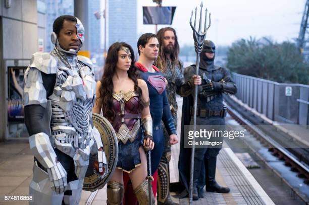 The characters Cyborg Wonder Woman Superman Aquaman and Batman from the Justice League film pose in character on the London Underground during a...
