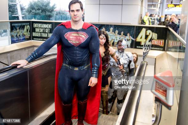 The characters Superman, Wonder Woman; Cyborg and Aquaman from the Justice League film pose in character on the London Underground during a photocall...