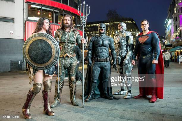 The characters Wonder Woman Aquaman Batman Cyborg and Superman from the Justice League film poses in character outisde before the UK premier during a...