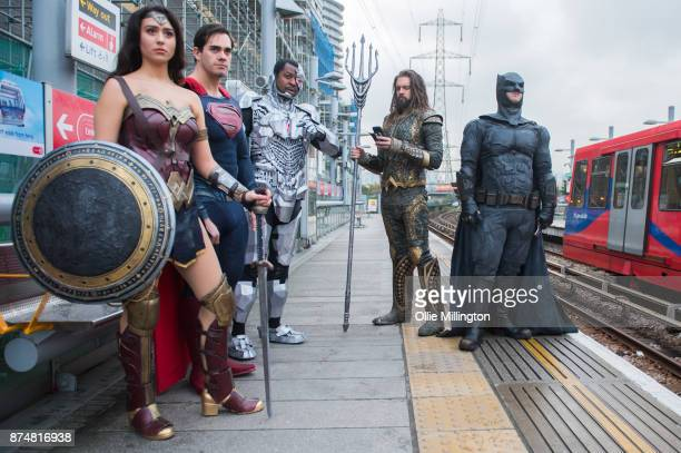The characters Wonder Woman Superman Cyborg and Batman from the Justice League film pose in character on the London Underground during a photocall en...