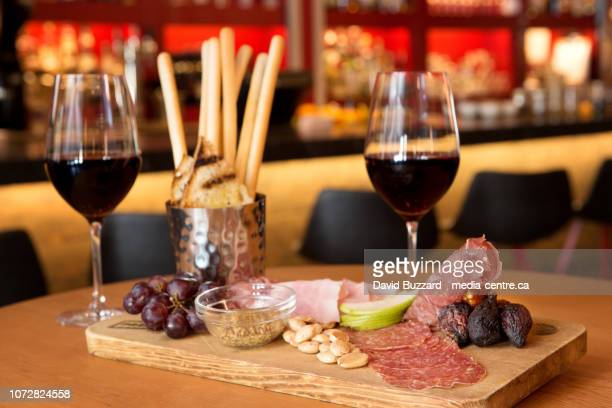 the charcuterie board at the newly renovated cure lounge at thenita lake lodge.  tuesday, march 27, 2018. - charcuteria fotografías e imágenes de stock