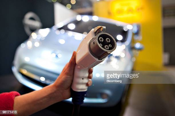The charger for a Nissan Leaf electric vehicle is displayed for a photograph during a media preview of the New York International Auto Show in New...