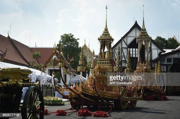 The chariot which will be used to transport the Supreme Patriarch and the royal chariot which will be used to carry the body of the late Thai King...