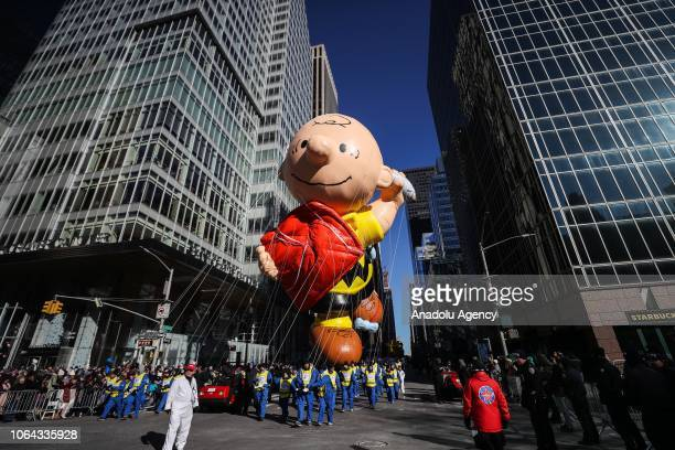 The Charlie Brown balloon floats above the crowd during the Macy's Thanksgiving Day Parade on November 22, 2018 in New York City, United States.