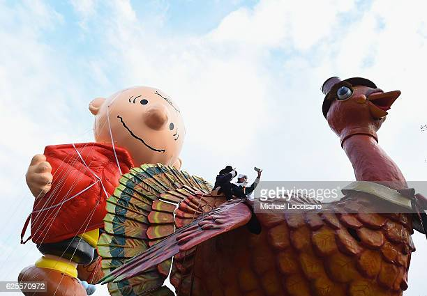 The Charlie Brown Balloon floats behind the turkey during the 90th Annual Macy's Thanksgiving Day Parade on November 24 2016 in New York City
