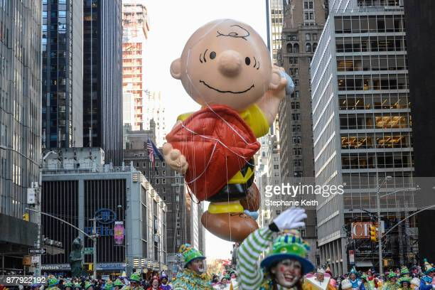 The Charlie Brown balloon floats on 6th Ave during the annual Macy's Thanksgiving Day parade on November 23 2017 in New York City The Macy's...