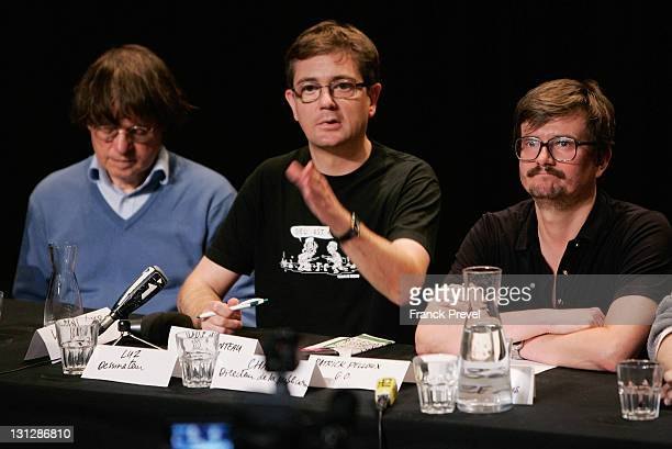 The Charlie Hebdo's cartoonists Cabu Charb and Luz attend a press conference at Theatre du RondPoint on November 3 2011 in Paris France The offices...