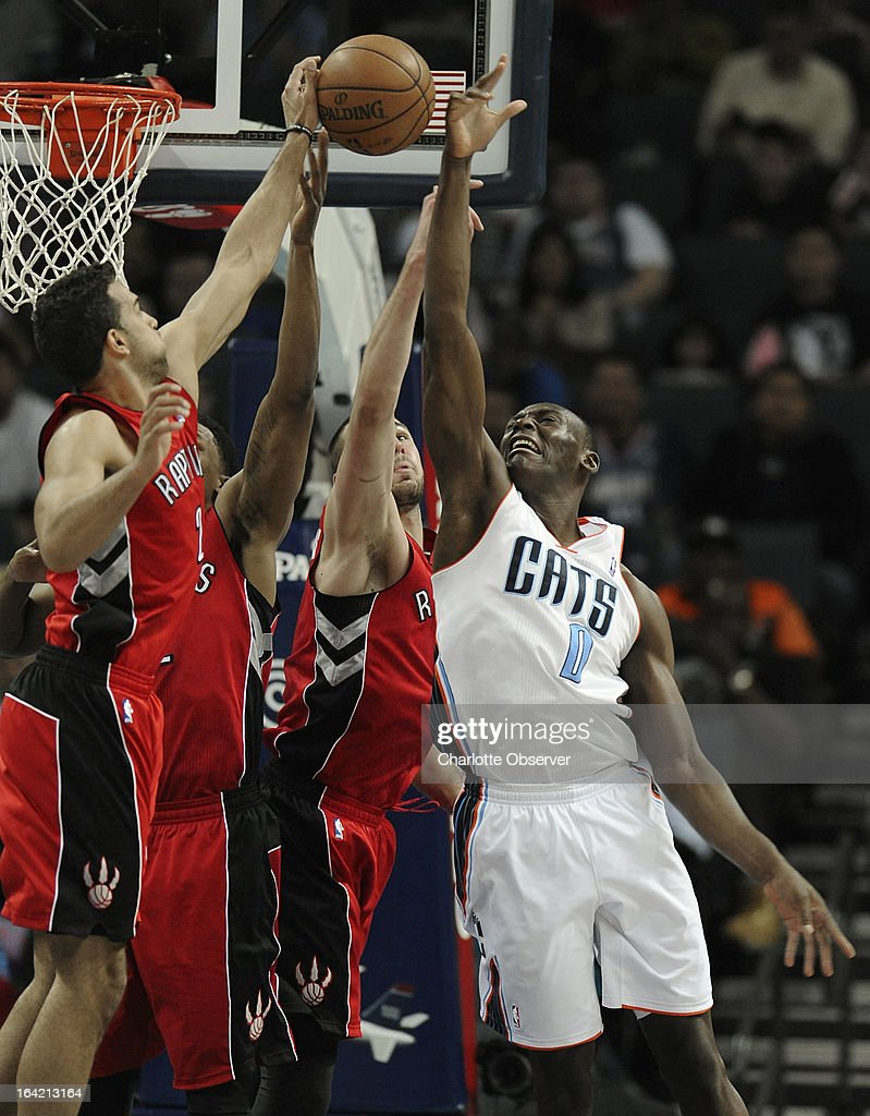 The Charlotte Bobcats' Bismack Biyombo fights for control of a rebound with the Toronto Raptors during second-half action at Time Warner Cable Arena in Charlotte, North Carolina, on Wednesday, March 20, 2013. Charlotte won, 107-101.