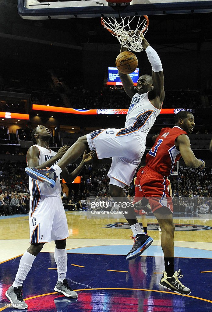 The Charlotte Bobcats' Bismack Biyombo gets a dunk over the Los Angeles Clippers' Chris Paul, right, in the first half at Time Warner Cable Arena in Charlotte, North Carolina, on Wednesday, December 12, 2012. The Clippers won, 100-94.