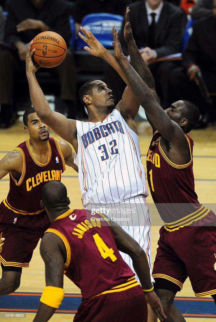 The Charlotte Bobcats' Boris Diaw (32) fights to get a shot off over the Cleveland Cavaliers J.J. Hickson, right, in second-half action at Time Warner Cable Arena in Charlotte, North Carolina, on Wednesday, December 29, 2010. Charlotte defeated Cleveland, 101-92.
