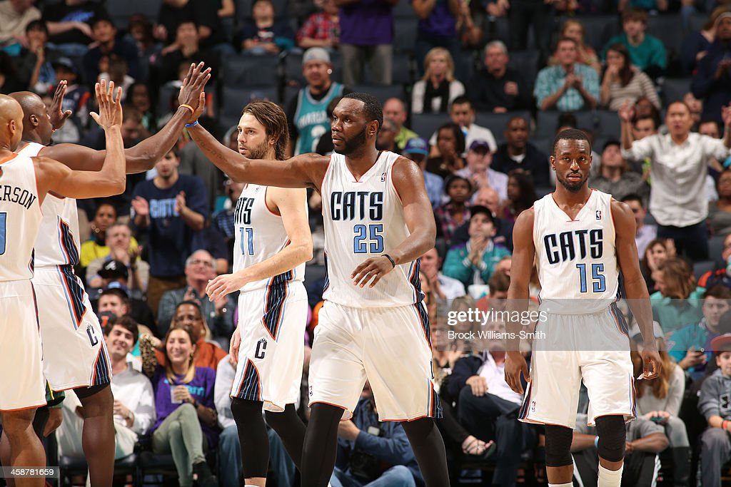 The Charlotte Bobcats congratulate Al Jefferson #25 during the game against the Utah Jazz at the Time Warner Cable Arena on December 21, 2013 in Charlotte, North Carolina.