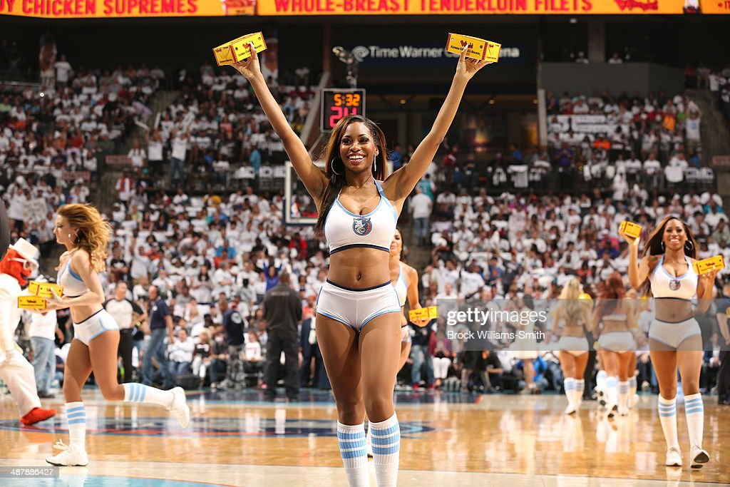 The Charlotte Bobcats dance team hand out giveaways during a game against the Miami Heat in Game Three of the Eastern Conference Quarterfinals of the 2014 NBA playoffs at the Time Warner Cable Arena on April 26, 2014 in Charlotte, North Carolina.