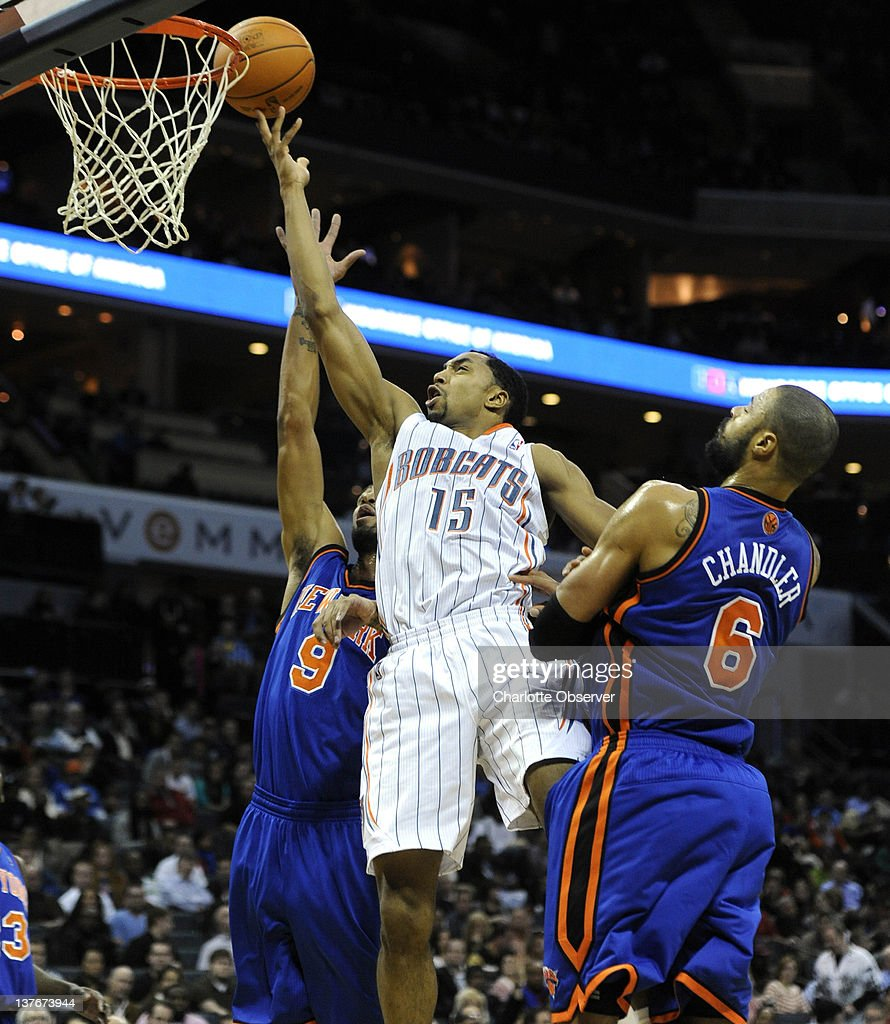 The Charlotte Bobcats' Gerald Henderson (15) drives between the New York Knicks' Jared Jeffries (9) and Tyson Chandler (6) in the first half at Time Warner Cable Arena in Charlotte, North Carolina, on Tuesday, January 24, 2012. New York rolled, 111-78.