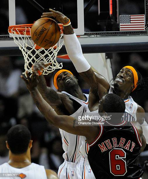 The Charlotte Bobcats' Gerald Wallace blocks the shot of the Chicago Bulls' Ronald Murray as Charlotte's Stephen Jackson lends a hand during the...