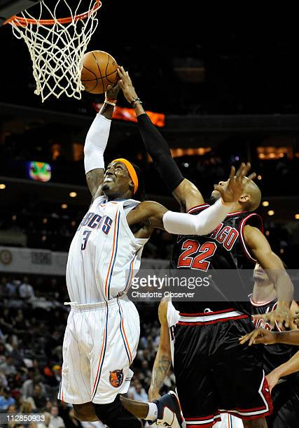 The Charlotte Bobcats' Gerald Wallace is fouled by the Chicago Bulls' Taj Gibson at Time Warner Cable Arena in Charlotte North Carolina on Wednesday...