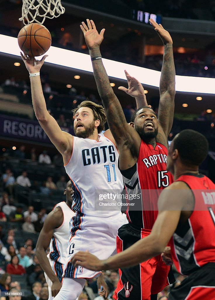The Charlotte Bobcats' Josh McRoberts, left, fights his way to the basket past the Toronto Raptors' Amir Johnson (15) and DeMar DeRozan during first-half action at Time Warner Cable Arena in Charlotte, North Carolina, on Wednesday, March 20, 2013.