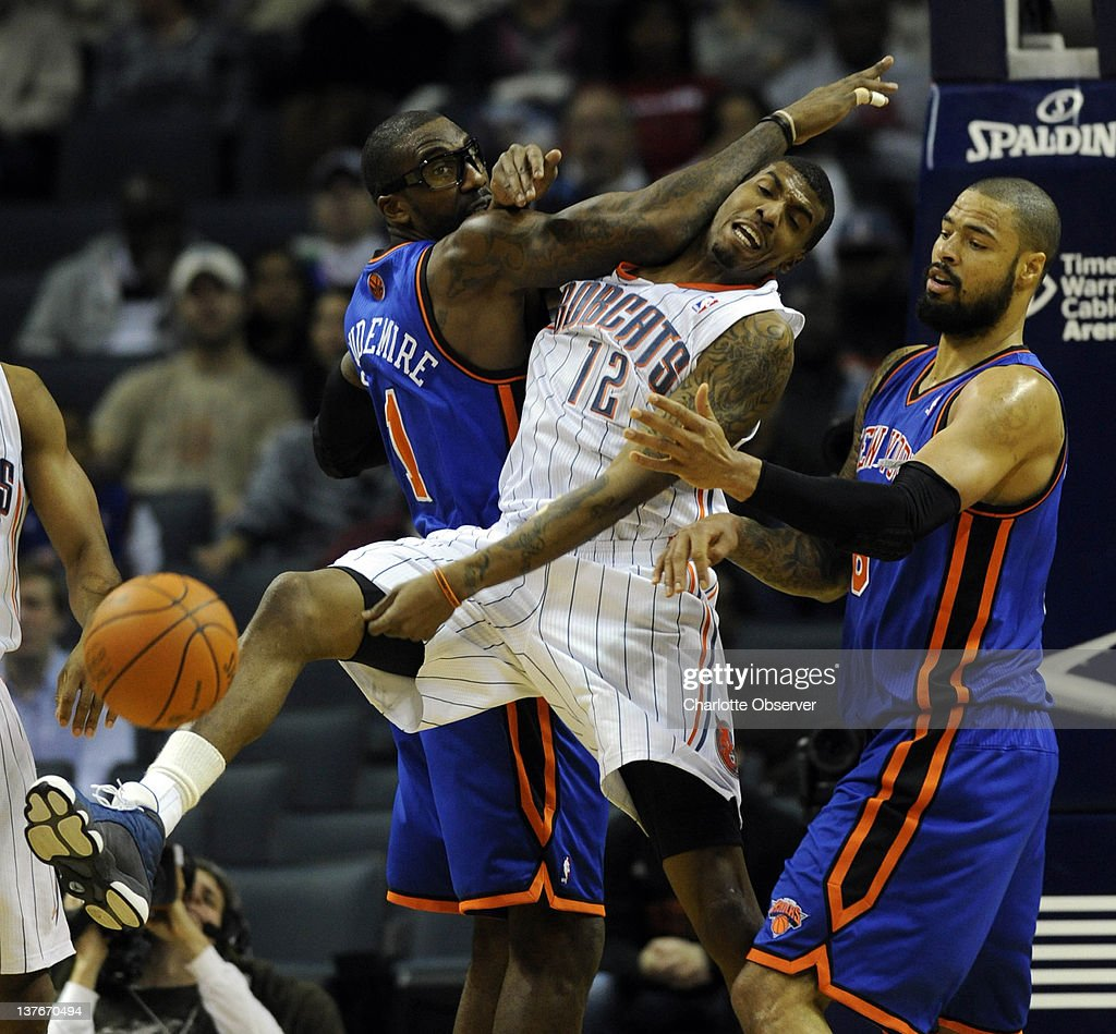 The Charlotte Bobcats' Tyrus Thomas (12) tries to grab a rebound between the New York Knicks' Amare Stoudemire and Tyson Chandler, right, during the first half at Time Warner Cable Arena in Charlotte, North Carolina, on Tuesday, January 24, 2012.