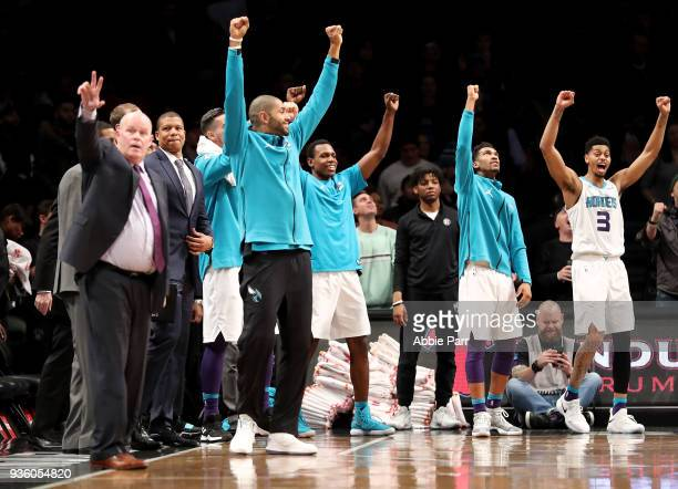 The Charlotte Hornets bench celebrates late in the fourth quarter against the Brooklyn Nets during their game at Barclays Center on March 21 2018 in...