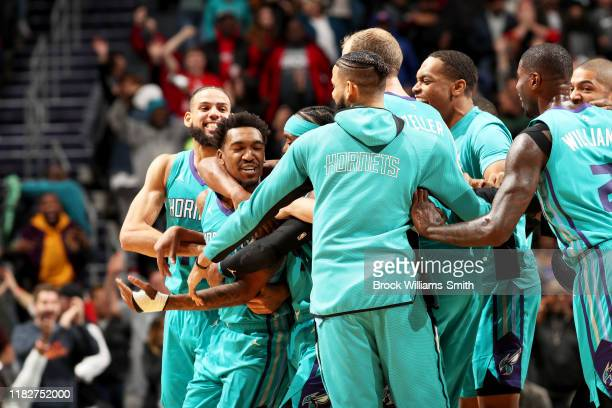 The Charlotte Hornets celebrate a game winning shot by Malik Monk of the Charlotte Hornets after a game against the Detroit Pistons on November 15,...
