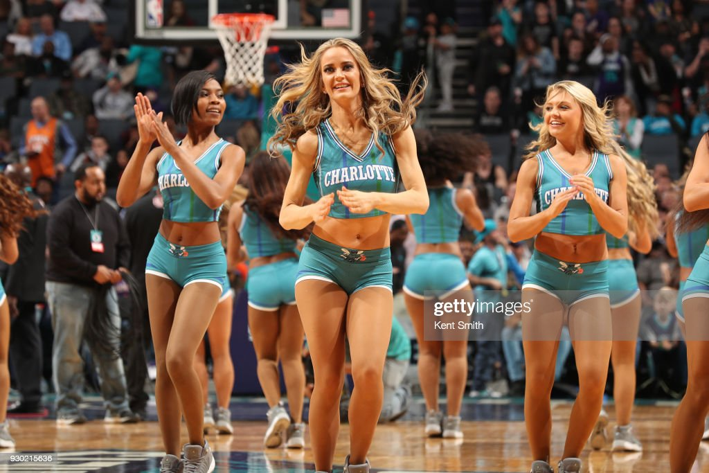The Charlotte Hornets dance team celebrates during the game against the Phoenix Suns on March 10, 2018 at Spectrum Center in Charlotte, North Carolina.