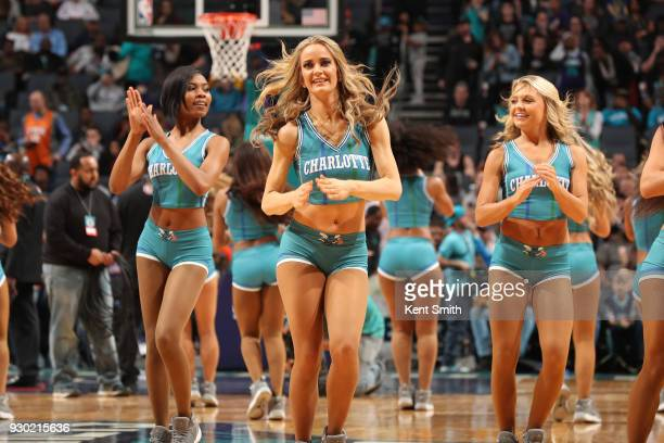 The Charlotte Hornets dance team celebrates during the game against the Phoenix Suns on March 10 2018 at Spectrum Center in Charlotte North Carolina...