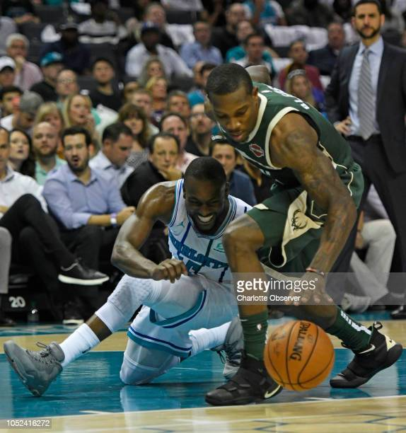 The Charlotte Hornets' Kemba Walker tries to gain control of the ball from the Milwaukee Bucks' Eric Bledsoe in the second half at the Spectrum...