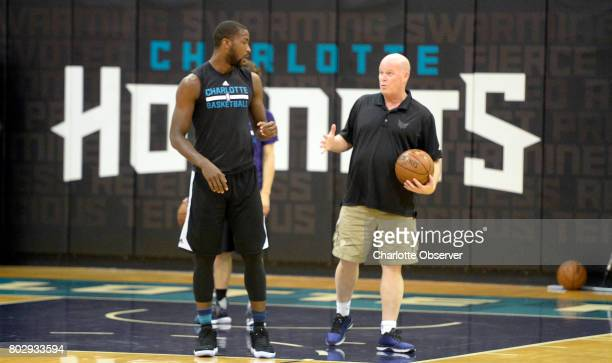 The Charlotte Hornets' Michael KiddGilchrist left works with head coach Steve Clifford after the team's summer league squad finished practicing at...