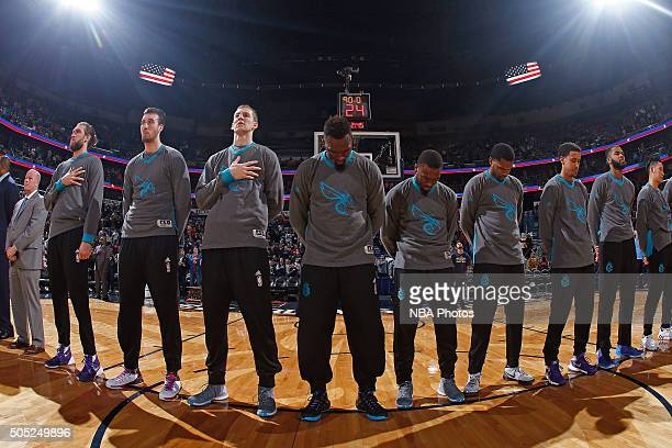The Charlotte Hornets stand on the court before the game against the New Orleans Pelicans on January 15 2016 at the Smoothie King Center in New...