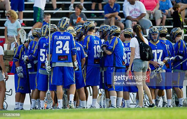 The Charlotte Hounds huddle up during a timeout in the game against the Ohio Machine at American Legion Memorial Stadium on June 8 2013 in Charlotte...