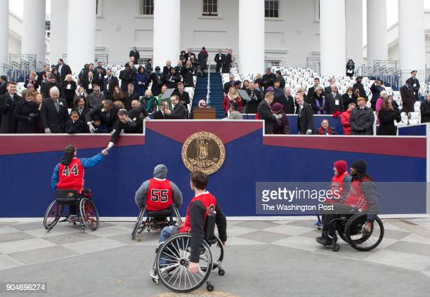 The Charlottesville Cardinals Wheelchair Basketball team take part in the Inaugural Parade Saturday January 13 2018 in Richmond Virginia