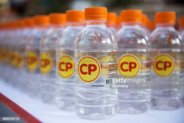 The Charoen Pokphand Group logo is seen on bottles of water sitting on a table during a news conference at the US ambassador's residence in Bangkok...